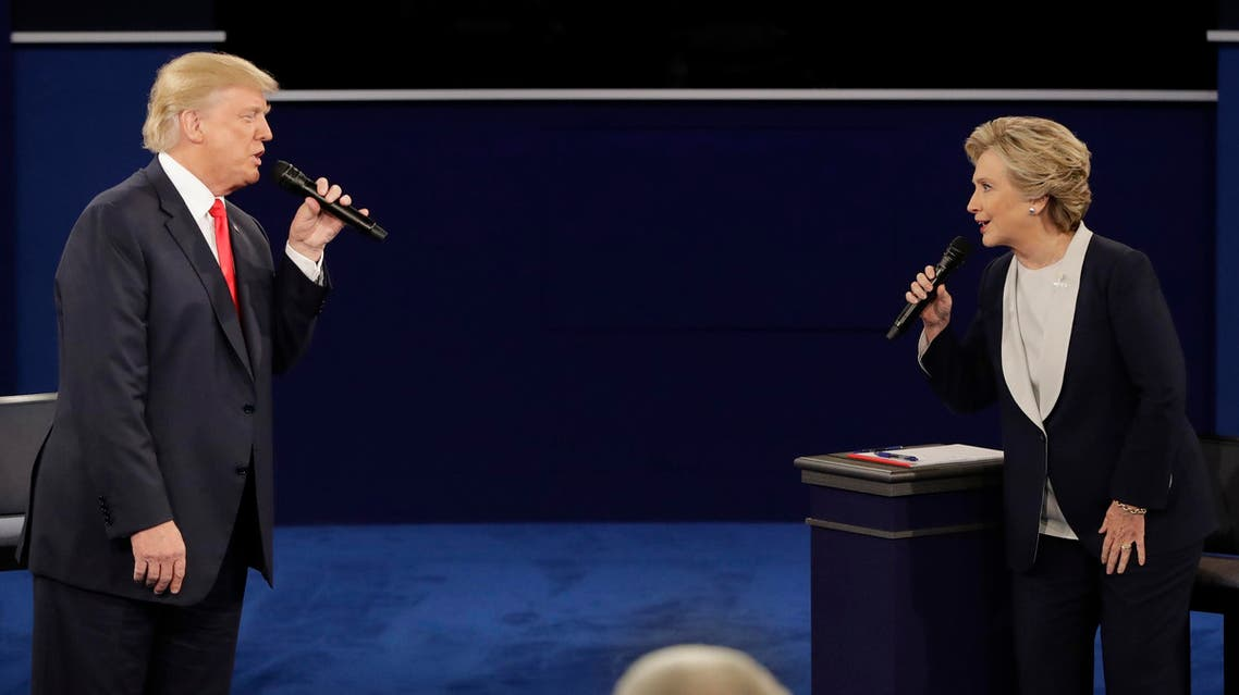 Republican presidential nominee Donald Trump and Democratic presidential nominee Hillary Clinton exchange ideas during the second presidential debate at Washington University in St. Louis, Sunday, Oct. 9, 2016. (AP)