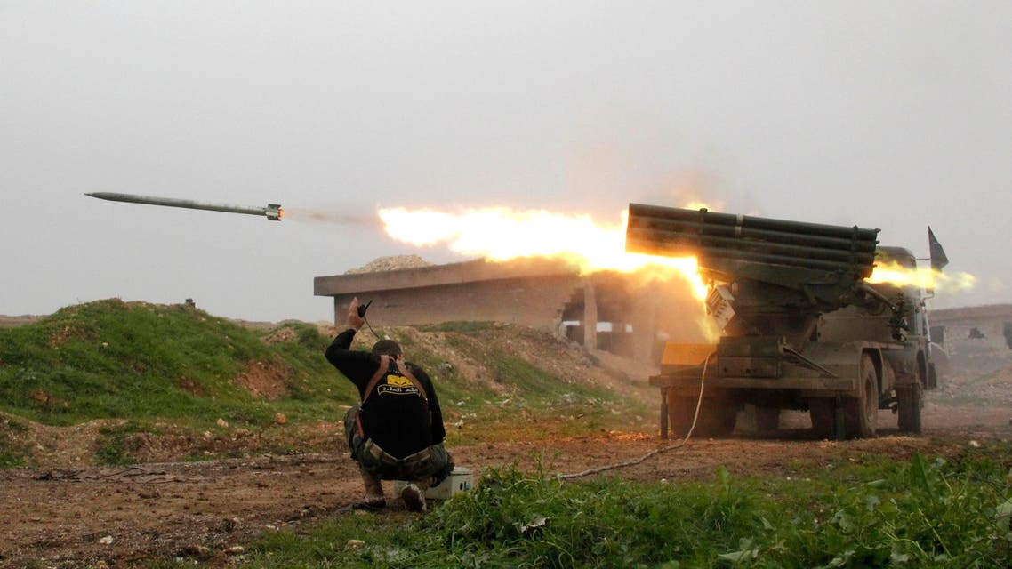 Al-Furqan brigade fighters, part of the Free Syrian Army, launch a Grad rocket towards forces loyal to Syria's president Bashar Al-Assad located in Mork town, Hama. (Reuters)