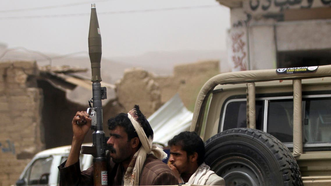 Followers of Yemen's al-Houthi group ride in an open vehicle while carrying weapons to secure a road in the northwestern province of Saada, June 4, 2013. (Reuters)