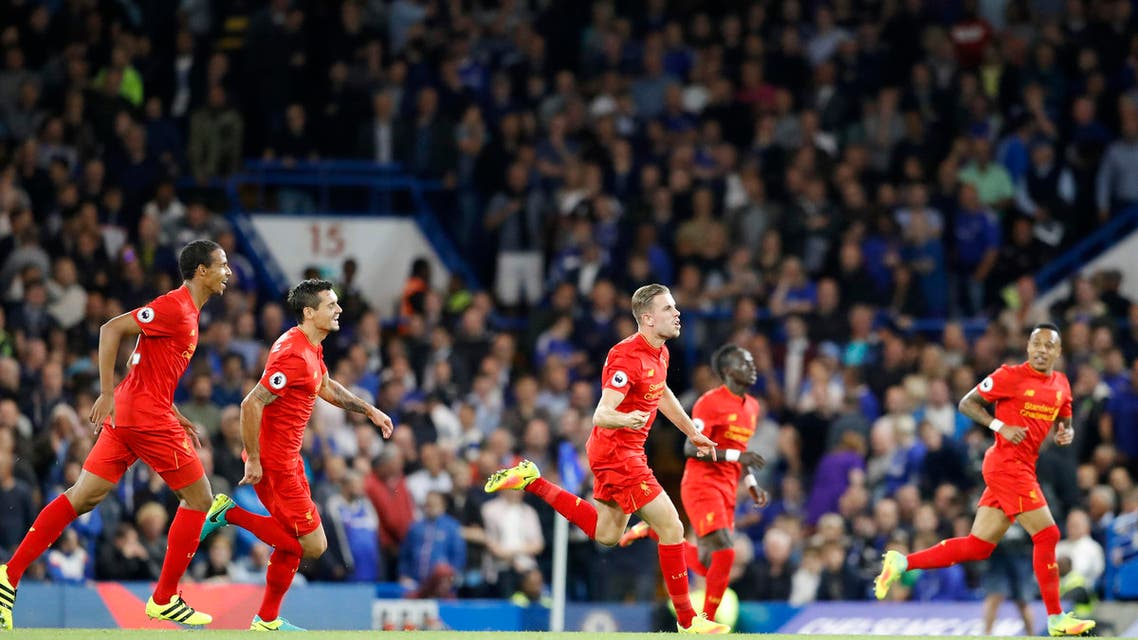 Liverpool's Jordan Henderson, center, celebrates after scoring his side's second goal during the English Premier League soccer match between Chelsea and Liverpool at Stamford Bridge stadium in London, Friday, Sept. 16, 2016. (AP)