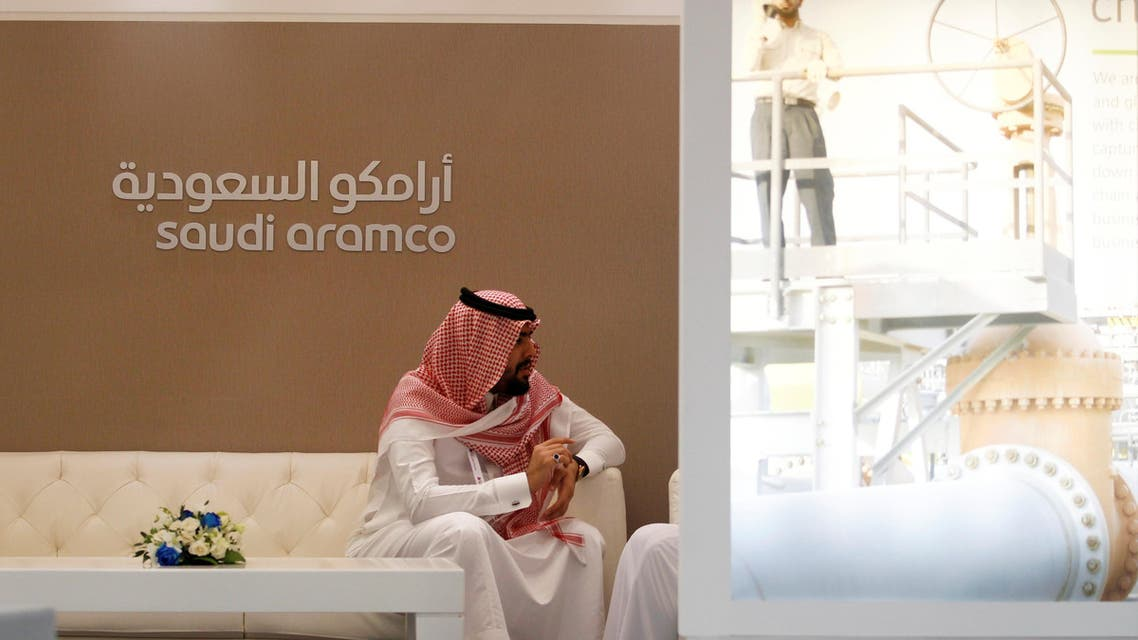 A Saudi Aramco employee sits in the area of its stand at the Middle East Petrotech 2016, an exhibition and conference for the refining and petrochemical industries, in Manama, Bahrain, September 27, 2016. REUTERS