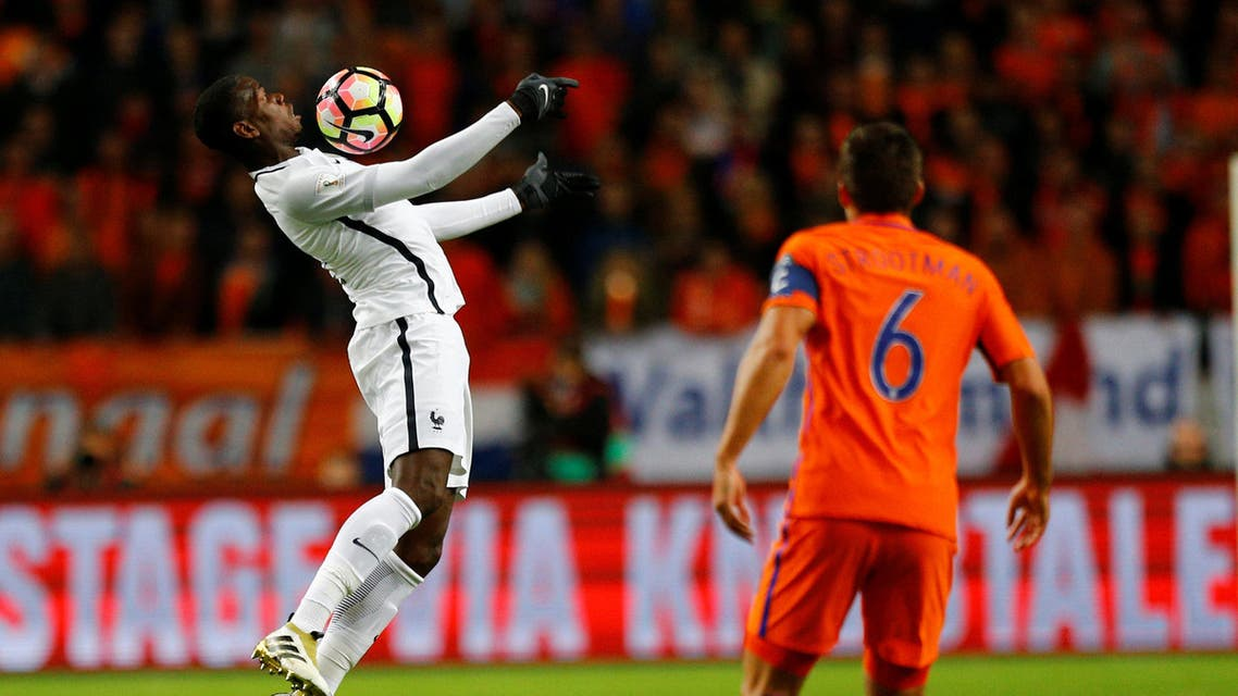 France's Paul Pogba in action as Netherlands' Kevin Strootman watches. REUTERS