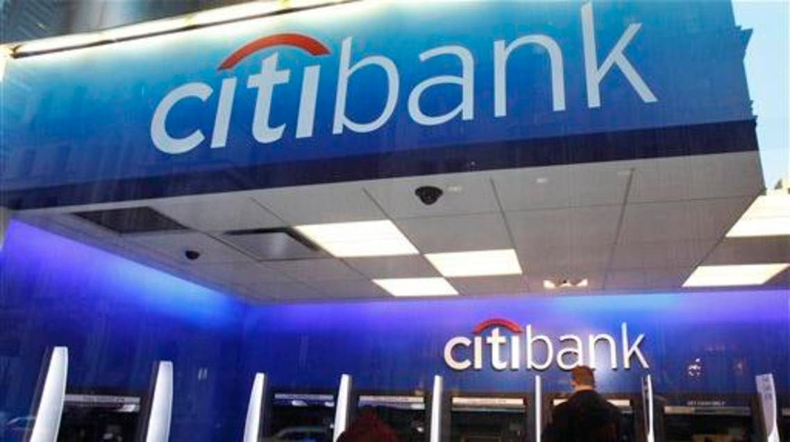 In this Jan. 6, 2012 file photo, a Citibank customer makes a transaction at an ATM, in New York. AP
