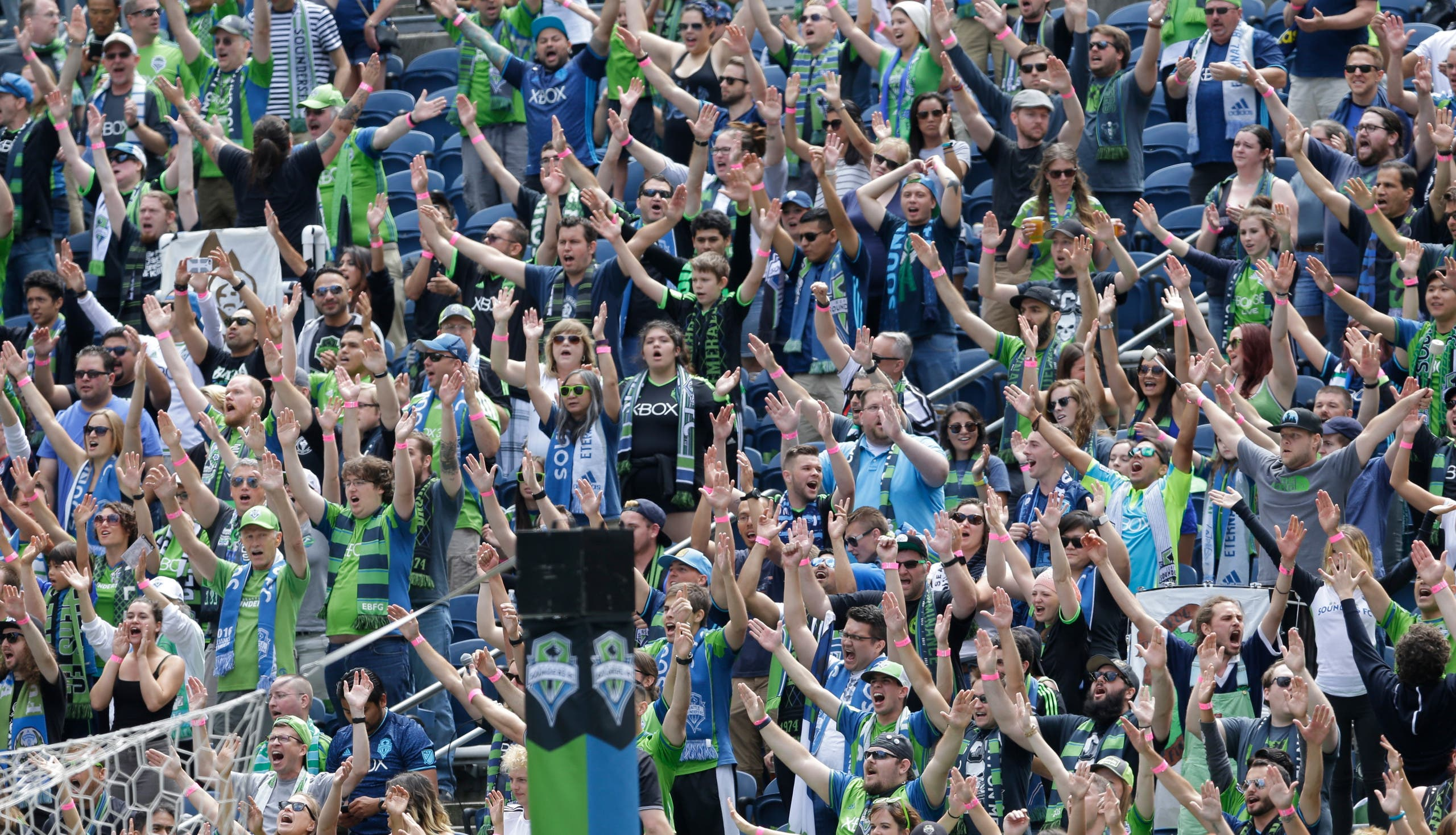 Members of the Emerald City Supporters and and other fans cheer at the start of an MLS soccer match against the Los Angeles Galaxy, Sunday, July 31, 2016, in Seattle. (AP)
