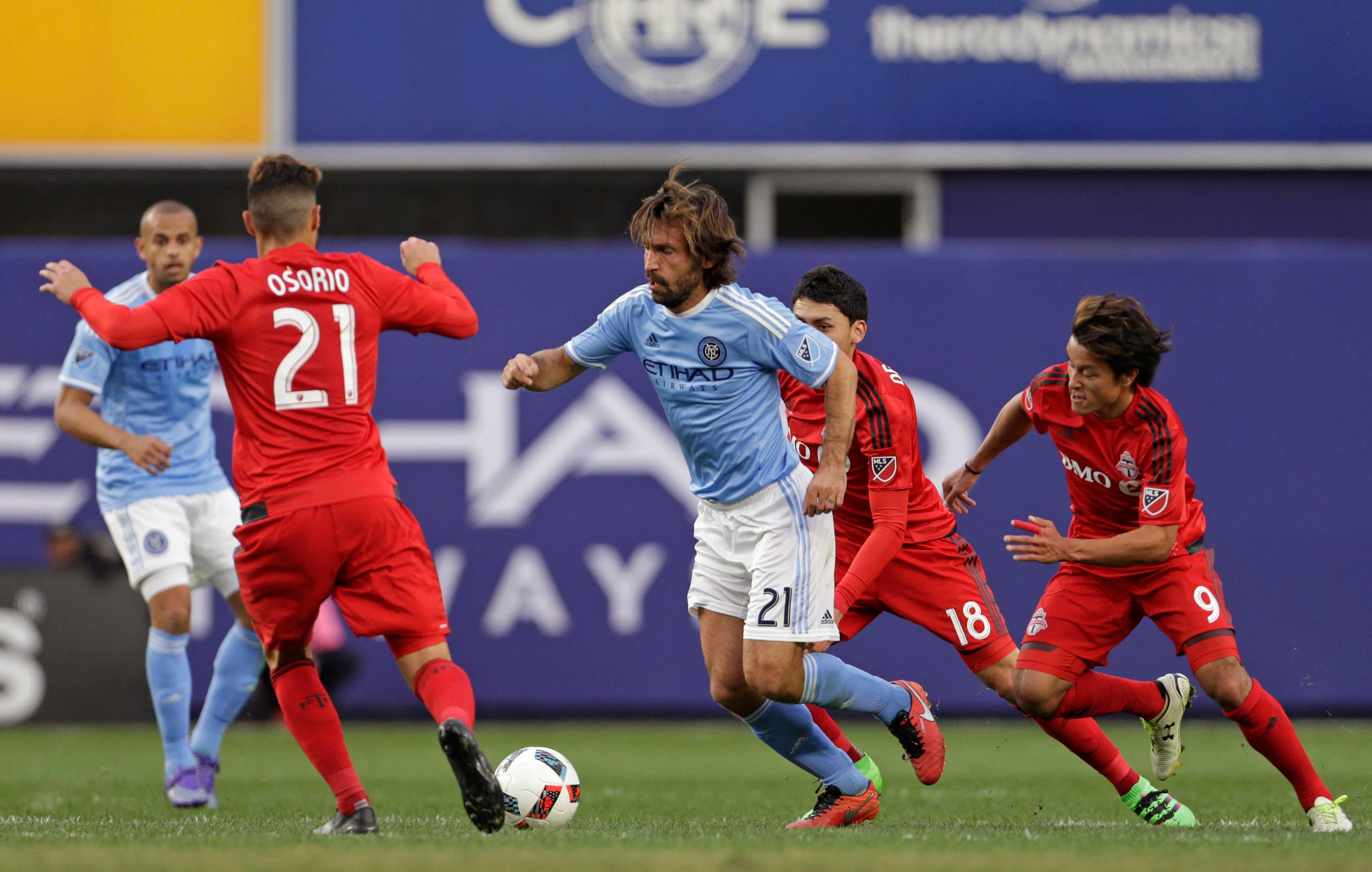 New York City FC midfielder Andrea Pirlo (21) controls the ball in front of Toronto FC midfielder Jonathan Osorio (21) during the first half of an MLS soccer game at Yankee Stadium on Sunday, March 13, 2016, in New York. (AP)