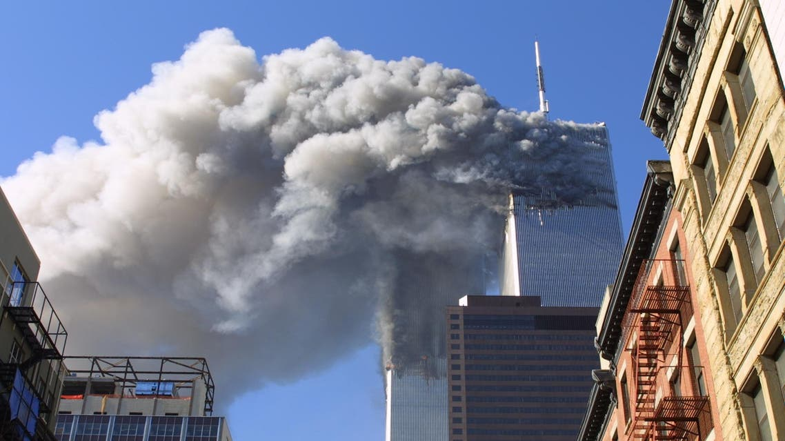 In this Sept. 11, 2001 file photo, the twin towers of the World Trade Center burn after hijacked planes crashed into them in New York. A person familiar with developments said Sunday, May 1, 2011 that Osama bin Laden is dead and the U.S. has the body. (AP