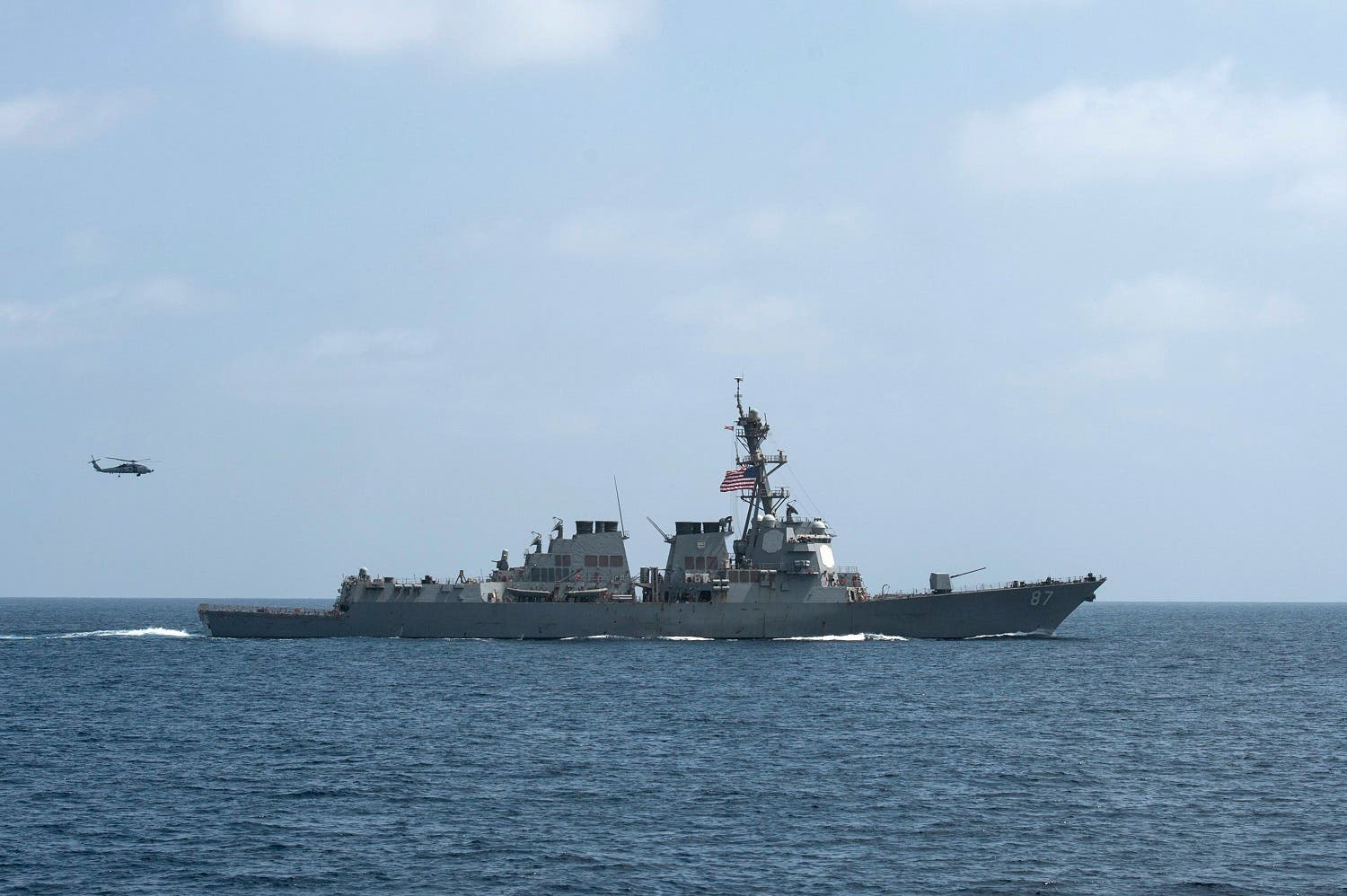 The U.S. Navy guided-missile destroyer USS Mason conducts divisional tactic maneuvers in the Gulf of Oman. (Reuters)