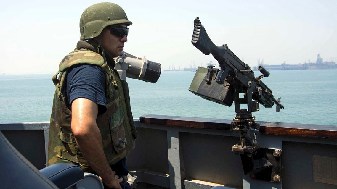 US Navy Fire Controlman 1st Class Jorge Correa scans for threats on the guided-missile destroyer USS Mason in Bahrain. (Reuters)