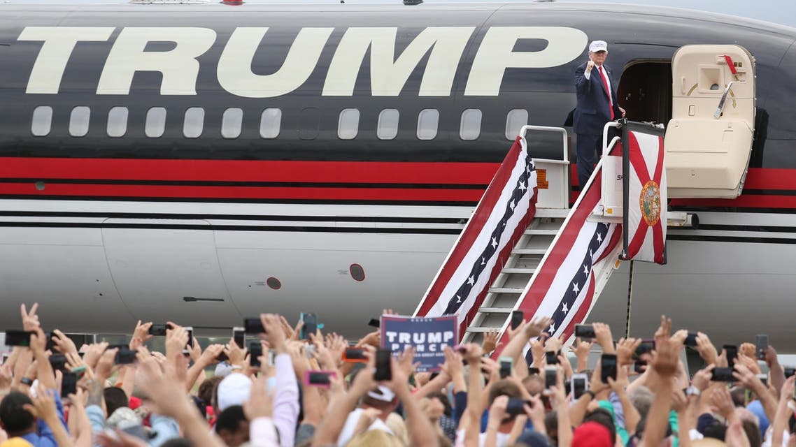 Republican presidential nominee Donald Trump pumps his fist to supporters at the conclusion of his campaign event on the tarmac at Lakeland Linder Regional Airport in Lakeland, Florida on October 12, 2016. (AFP)