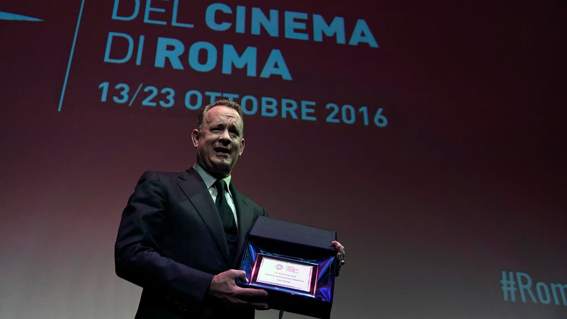 US Actor Tom Hanks poses after he received a Lifetime Achievement Award from Italian actress Claudia Cardinale on the opening day of Rome Film Festival on October 13, 2016. (AFP)