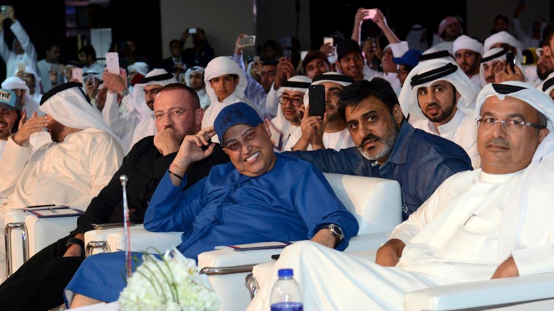 Dubai-based Indian businessman Raj Sahni (center) looks on during an auction in Dubai on October 8, 2016. Sahni, an owner of an international real estate company, paid around $9 million (33 million dirhams) for a Dubai license plate bearing the number 5. (AFP)