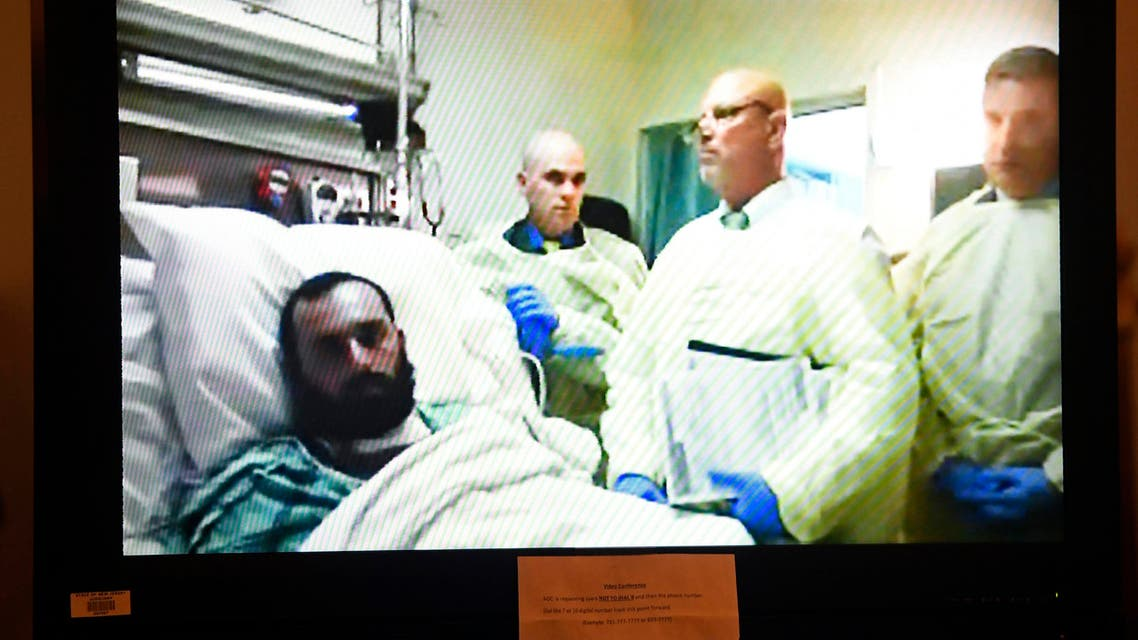 Ahmad Khan Rahimi, left, appears via video from his hospital bed in Newark, N.J., during a court hearing at the Union County Courthouse, Thursday, Oct. 13, 2016, in Elizabeth, N.J. (AP)