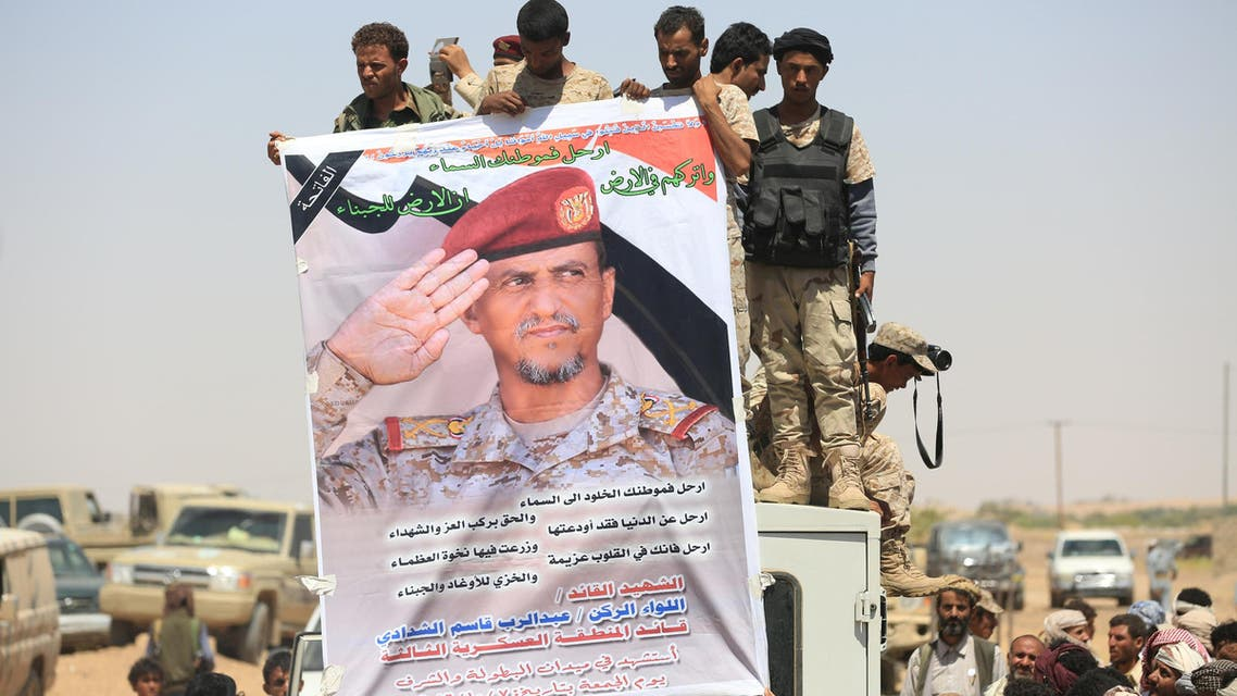 Pro-government soldiers hold a poster of Major-General Abdel-Rab al-Shadadi, a top general in forces loyal to Yemeni President Abd-Rabbu Mansour Hadi's government killed in fighting with Iran-aligned Houthi troops, during his funeral in Marib city, Yemen October 9, 2016. reuters