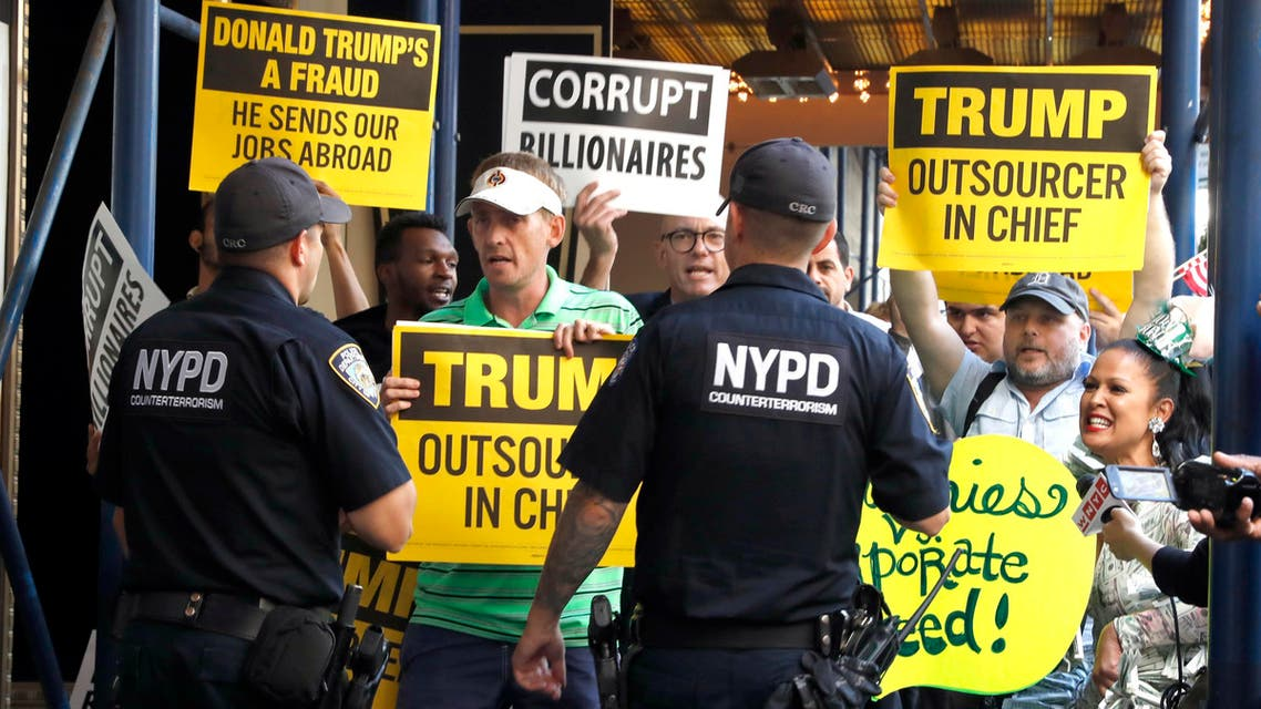 Police talks to demonstrators protesting outside the Waldorf Astoria hotel in New York, Thursday, Sept. 15, 2016, where Republican Presidential candidate Donald Trump is attending a luncheon. (AP)