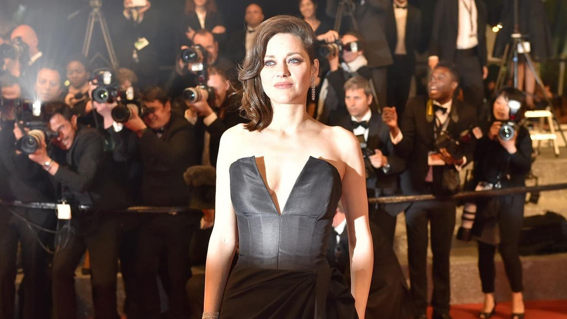 """French actress Marion Cotillard poses as she leaves on May 19, 2016 following the screening of the film """"It's Only The End Of The World (Juste La Fin Du Monde)"""" at the 69th Cannes Film Festival in Cannes, southern France. LOIC VENANCE / AFP"""