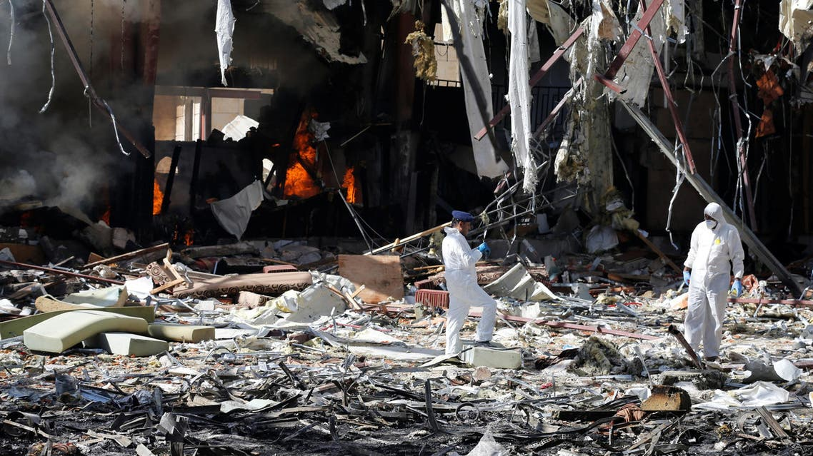 Forensic experts investigate the scene at the community hall where Saudi-led warplanes struck a funeral in Sanaa, the capital of Yemen. REUTERS