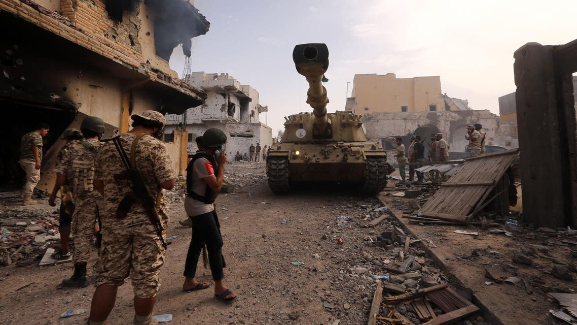 Members of the forces loyal to Libya's UN-backed Government of National Accord (GNA) gather in the coastal city of Sirte, east of the capital Tripoli, during their military operation to clear the Islamic State group's (IS) jihadists from the city, on October 14, 2016. Libya has been ravaged by unrest since the fall and death in 2011 of dictator Moamer Kadhafi and has also seen the jihadist Islamic State group establish a foothold. MAHMUD TURKIA / AFP