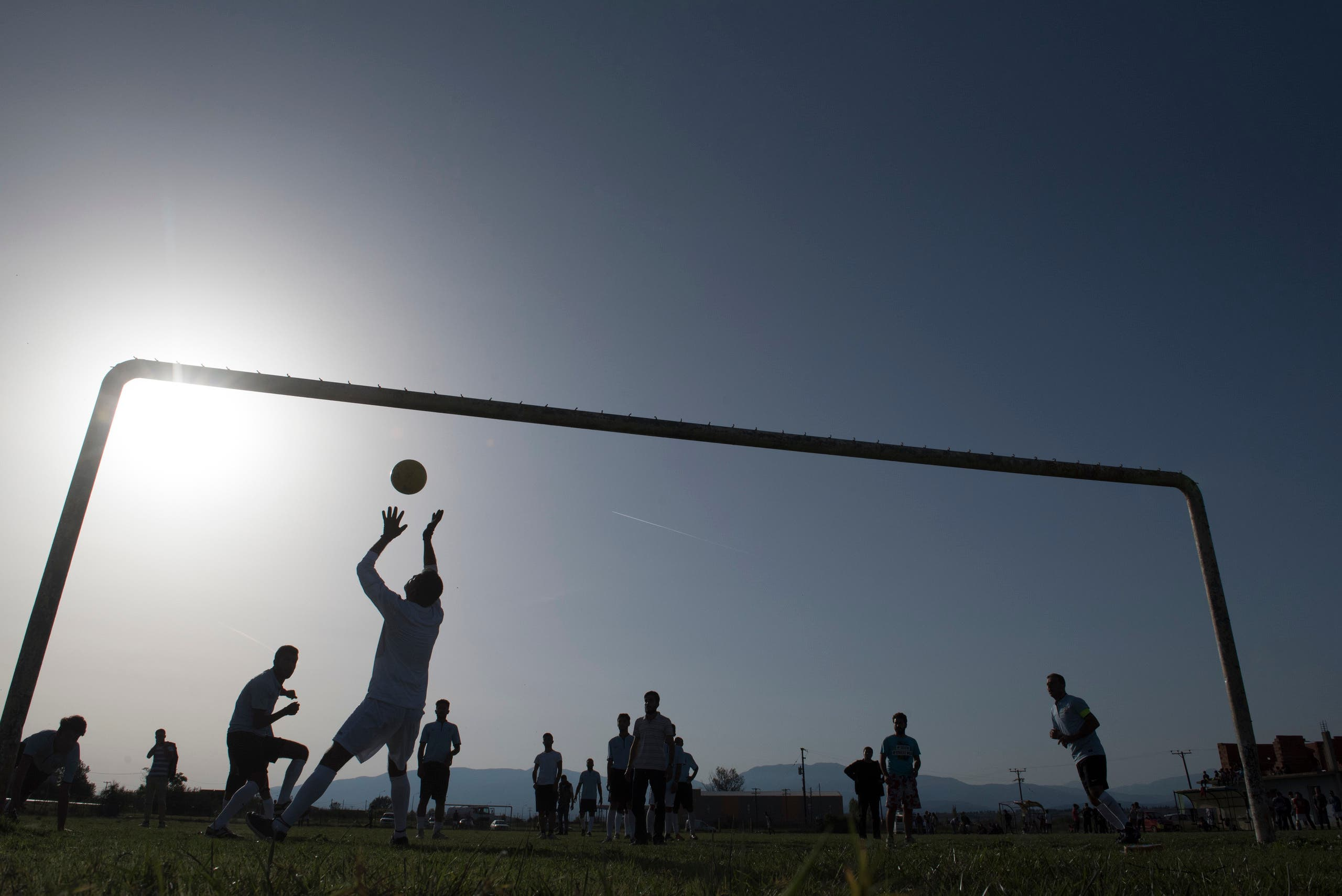 Refugees in Greece take a break, play soccer