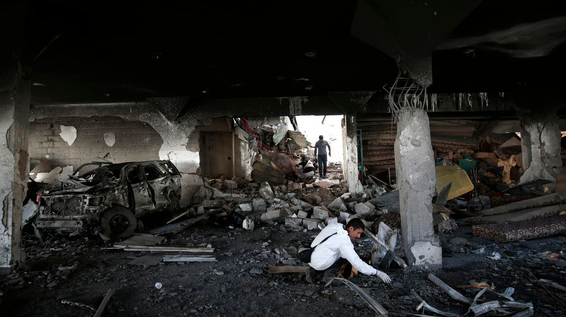A forensic expert inspects the rubble of destroyed funeral hall, two days after a coalition airstrike targeted it, in Sanaa, Yemen, Monday, Oct. 10, 2016.