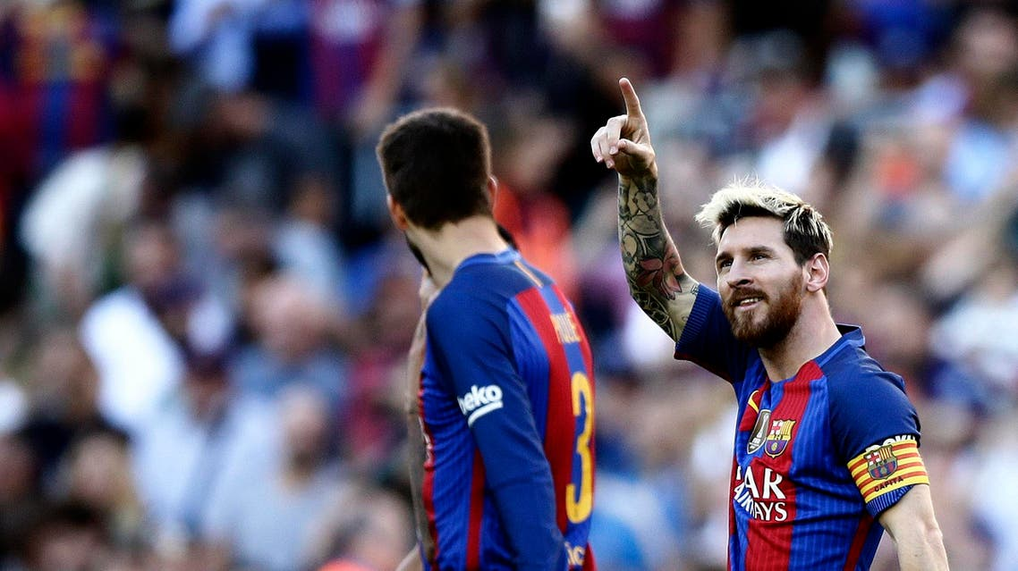 FC Barcelona's Lionel Messi celebrates after scoring during the Spanish La Liga soccer match between FC Barcelona and Deportivo Coruna at the Camp Nou in Barcelona, Spain, Saturday, Oct. 15, 2016. (AP