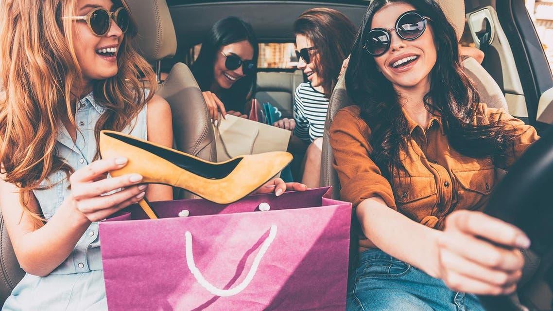 women shopping shutterstock