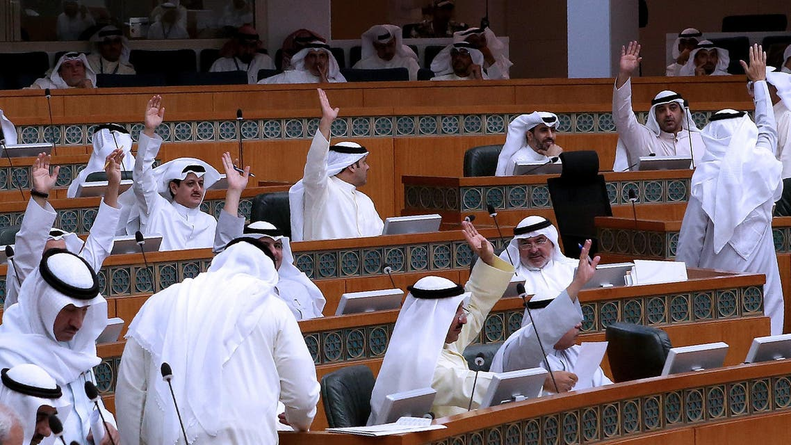 Kuwaiti MPs raise their hands as they vote during a parliament session at the Kuwait's national assembly in Kuwait City on July 3, 2016. AFP