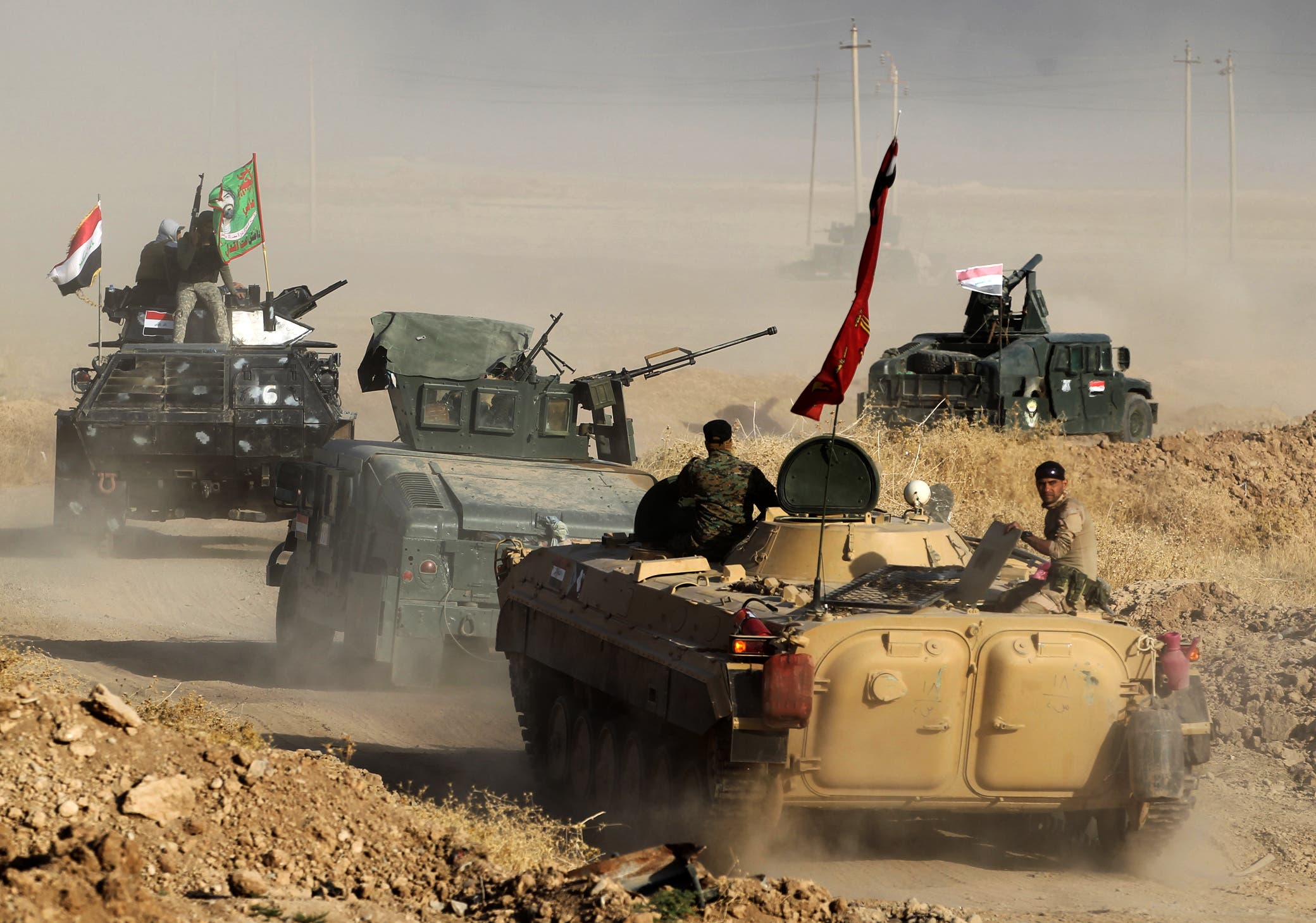 Iraqi forces deploy in the area of al-Shourah, some 45 km south of Mosul, as they advance towards the city to retake it from ISIS extremists, on October 17, 2016.  (AFP)