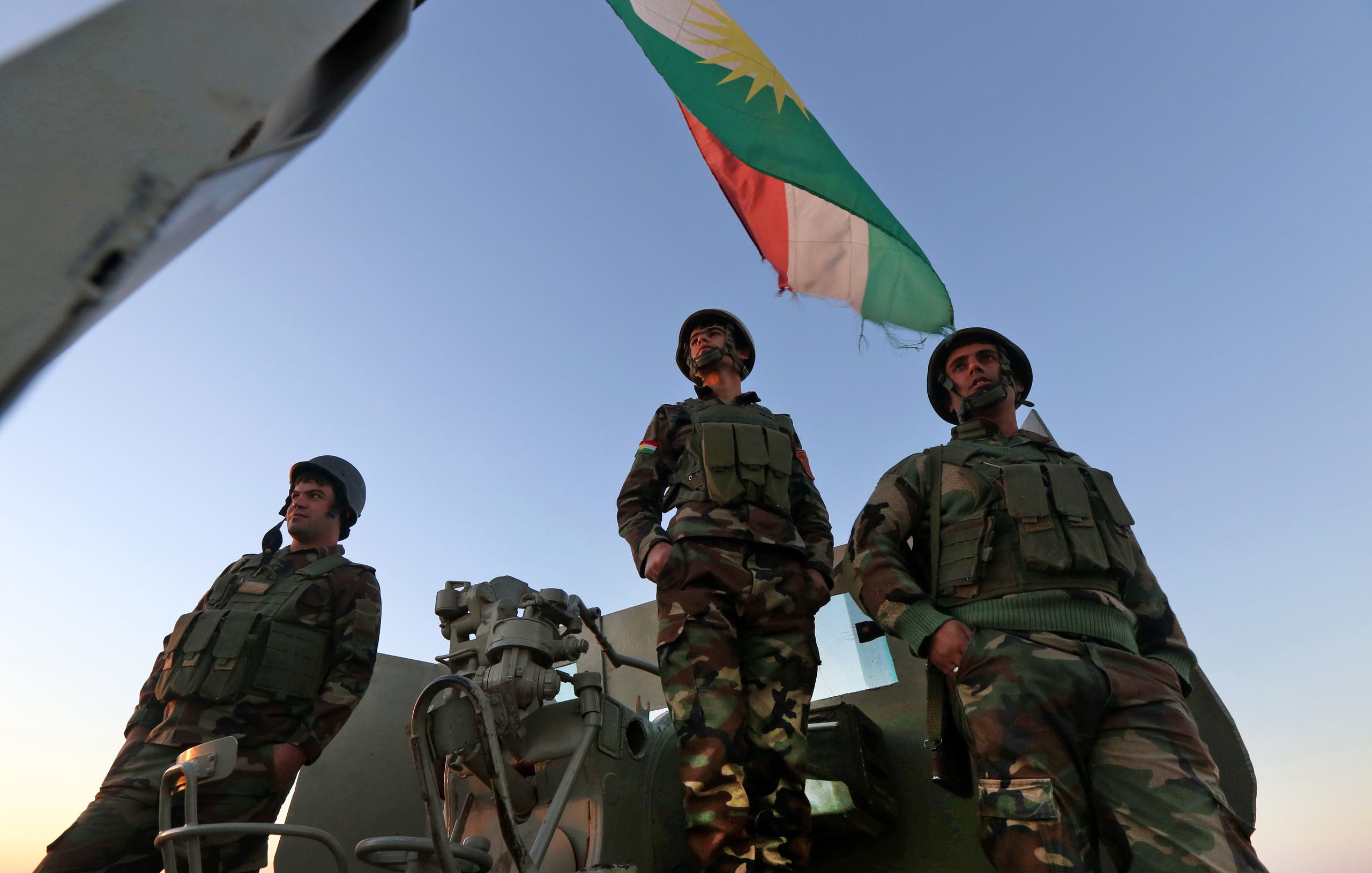 Iraqi Kurdish Peshmerga fighters hold a position on the top of Mount Zardak, about 25 kilometers east of Mosul, on October 17, 2016. (AFP)