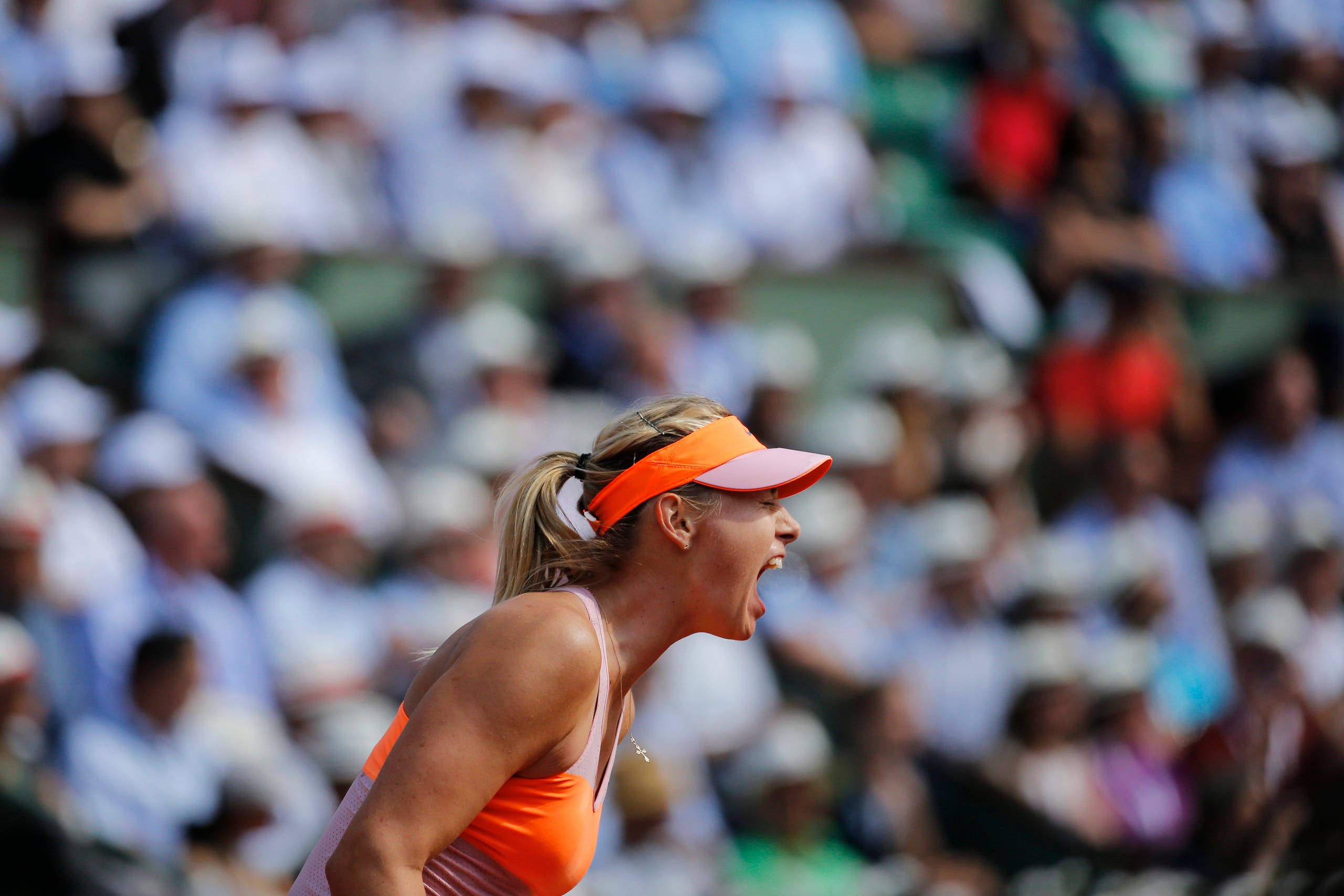 Maria Sharapova of Russia reacts during her women's semi-final match against Eugenie Bouchard of Canada at the French Open tennis tournament at the Roland Garros stadium in Paris June 5, 2014. REUTERS