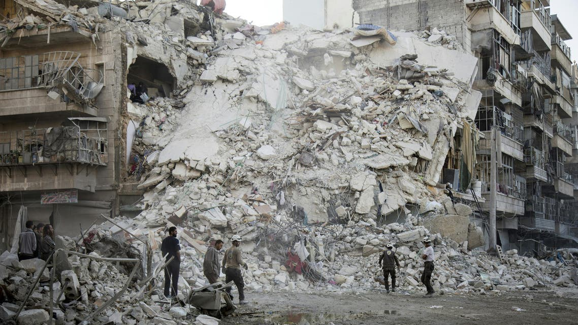Members of the Syrian Civil Defence, known as the White Helmets, search for victims amid the rubble of a destroyed building following reported air strikes in the rebel-held Qatarji neighbourhood of the northern city of Aleppo, on October 17, 2016. (AFP)
