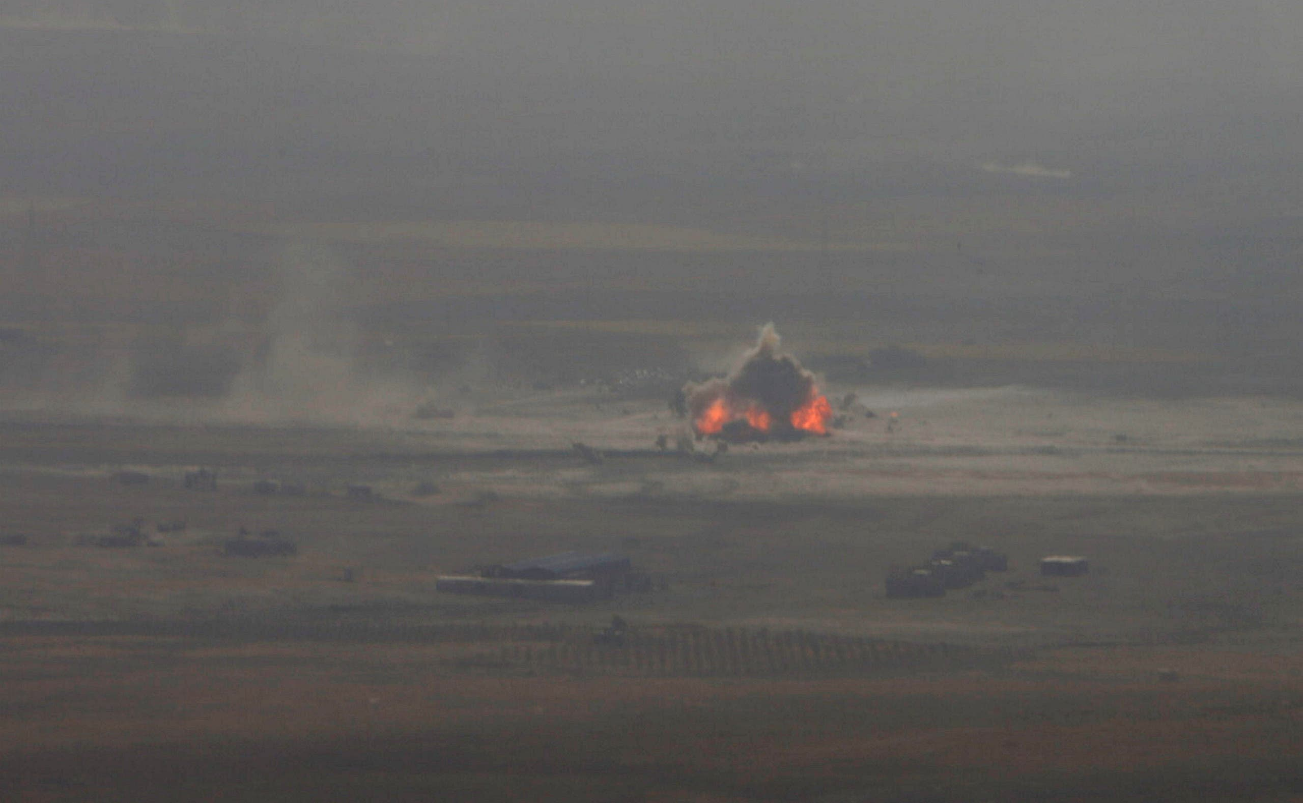 A car bomb attack is seen in the east of Mosul during clashes with ISIS militants, Iraq, October 17, 2016. (Reuters)