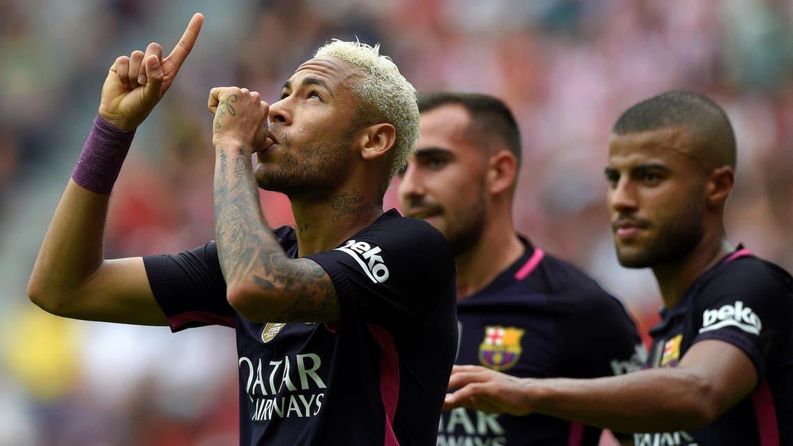Barcelona's Neymar celebrates his goal with teammates. REUTERS