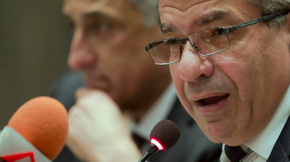 Minister of Finance Amr El-Garhy, right, and Central Bank Governor Tarek Amer speak during a press conference at the headquarters of the finance ministry in Cairo, Egypt, Thursday, Aug.11, 2016. (AP Photo/Amr Nabil)