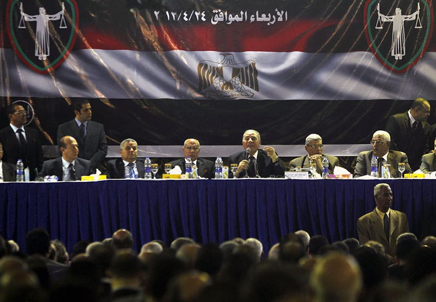 Ahmed al-Zend (with microphone in hand) addresses a meeting of Egyptian judges in April 2013. (File photo: Reuters)