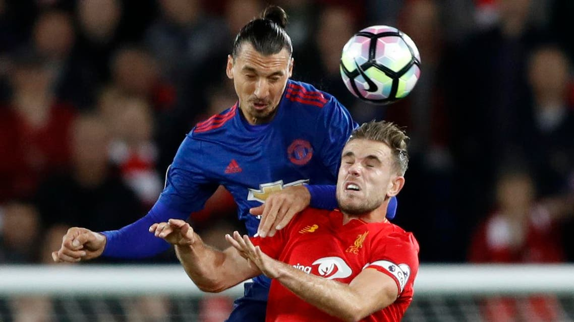 Manchester United's Zlatan Ibrahimovic in action with Liverpool's Jordan Henderson Action Images via Reuters