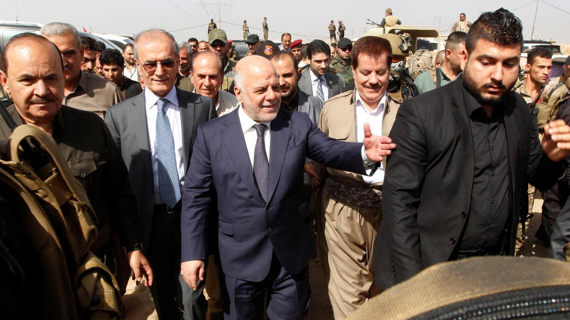 Iraqi Prime Minister Haider al-Abadi (C) gestures during his visit in Kirkuk, Iraq, October 14, 2016. (Reuters)
