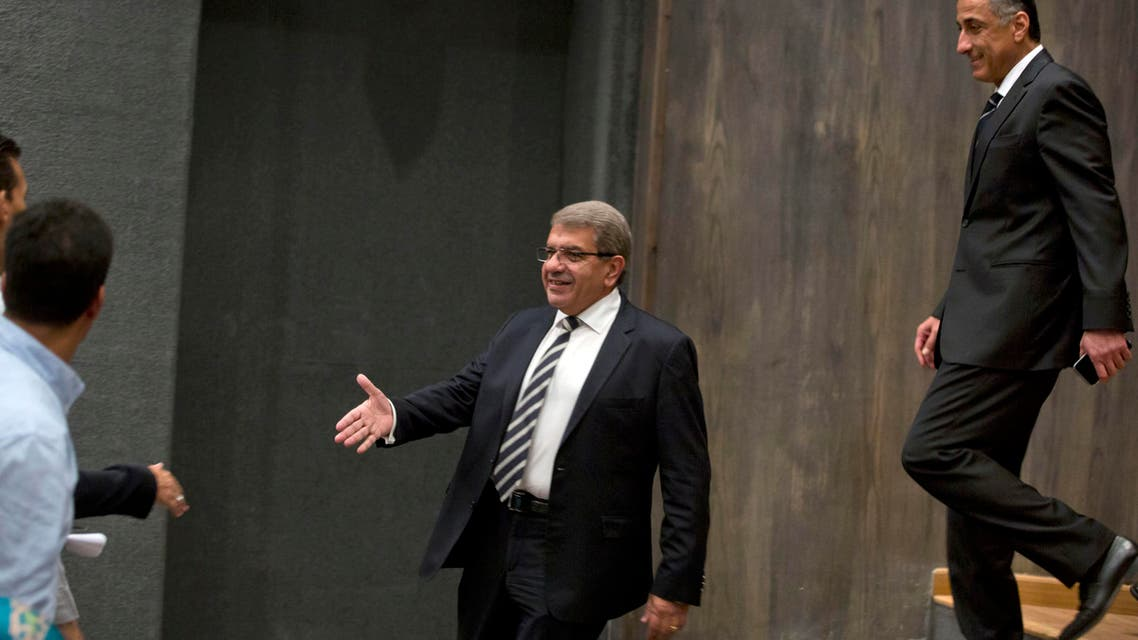 Egyptian Minister of Finance Amr El-Garhy (left), and Central Bank Governor Tarek Amer greet reporters before a press conference at the headquarters of the finance ministry in Cairo, Egypt, on Thursday, August 11, 2016. (AP)