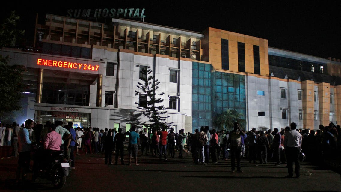 People gather outside the private Sum Hospital after a fire broke out in its intensive care unit, in Bhubaneswar, in the eastern Indian state of Orissa, Monday, Oct. 17, 2016. (AP)