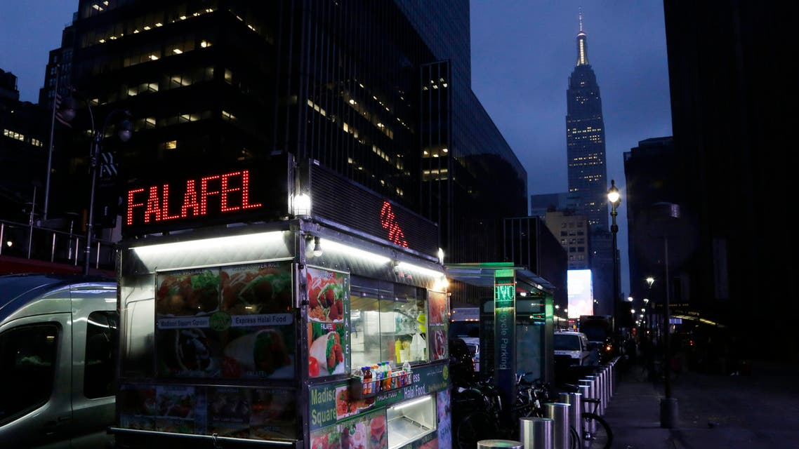 A food truck selling falafel and other halal food is shown outside Madison Square Garden, Wednesday, Feb. 10, 2016, in New York. (AP)
