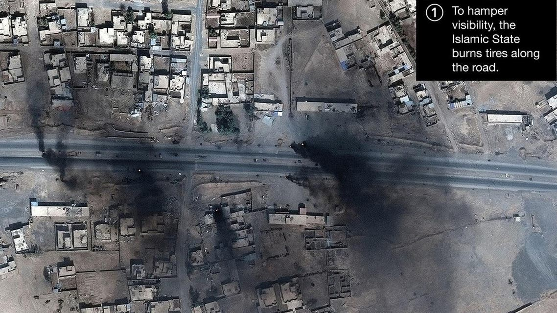 Smoke is seen in this satellite image of the city of Mosul in Iraq. (Reuters)