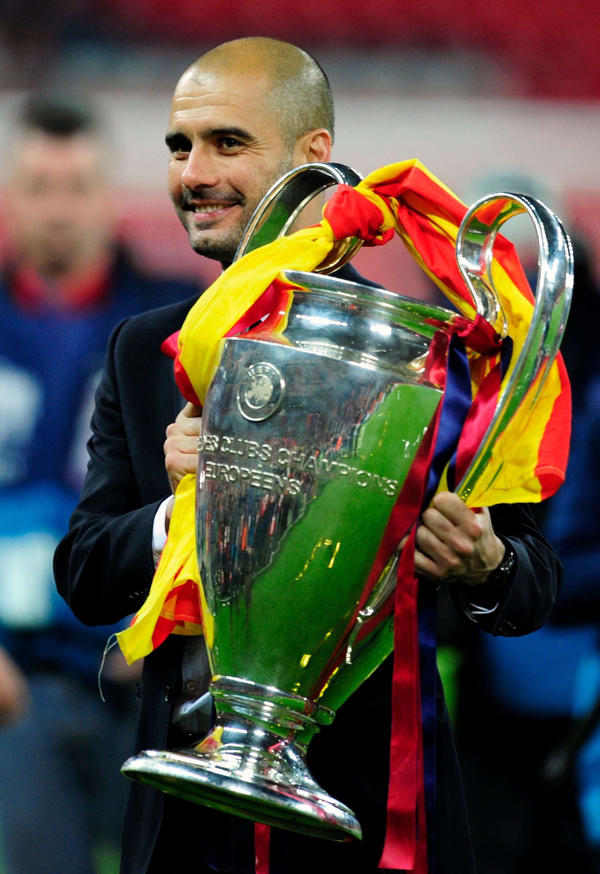 Barcelona's coach Pep Guardiola holds the trophy after winning the Champions League final soccer match against Manchester United at Wembley Stadium. (File Photo: AP)