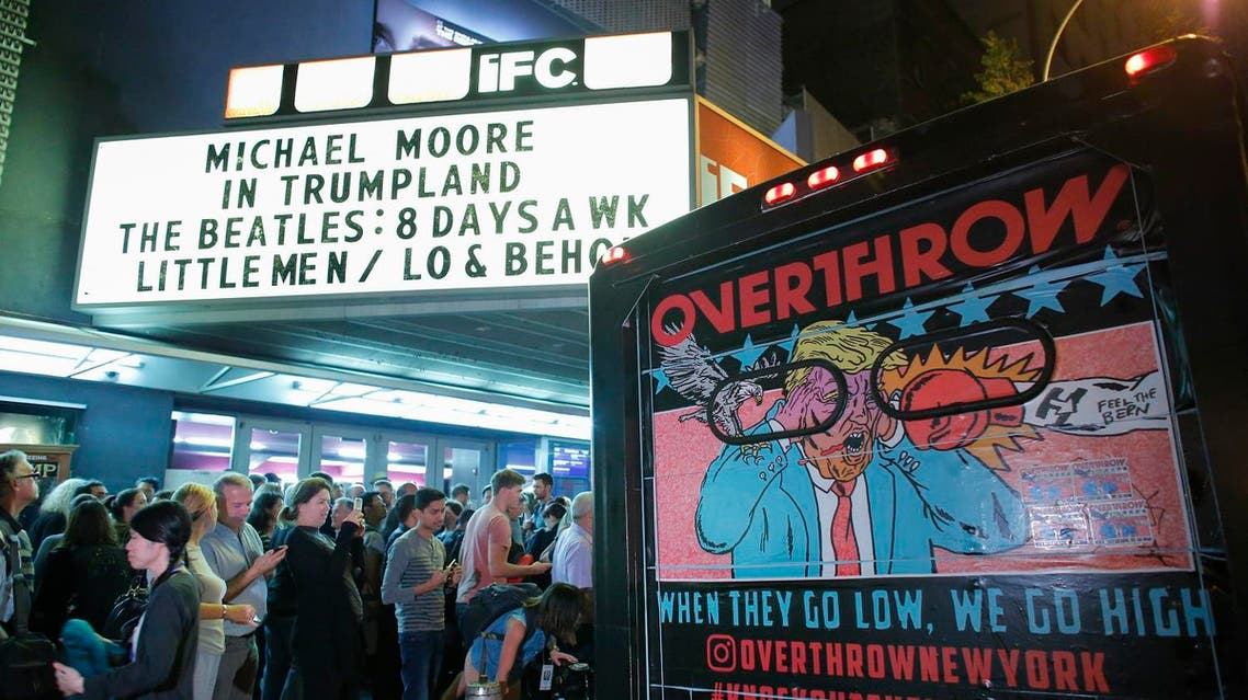 """People wait in line outside the IFC Theater before the debut of a surprise documentary about Republican nominee Donald Trump titled """"TrumpLand"""" by US filmmaker Michael Moore in New York on October 18, 2016. KENA BETANCUR / AFP"""