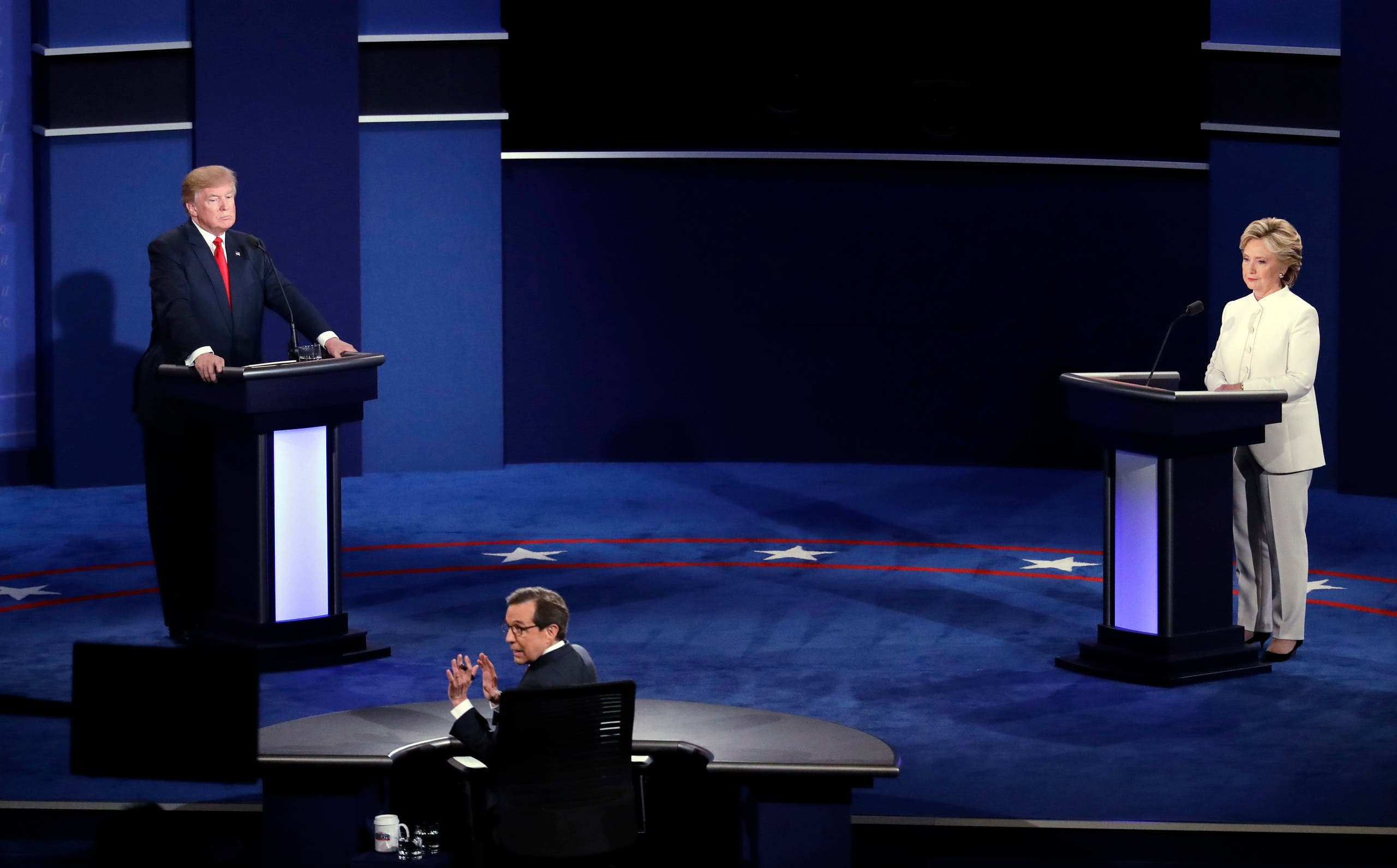 Moderator Chris Wallace, of FOX News, turns towards the audience as he questions Democratic presidential nominee Hillary Clinton and Republican presidential nominee Donald Trump during the third presidential debate at UNLV in Las Vegas, Wednesday, Oct. 19, 2016.(AP