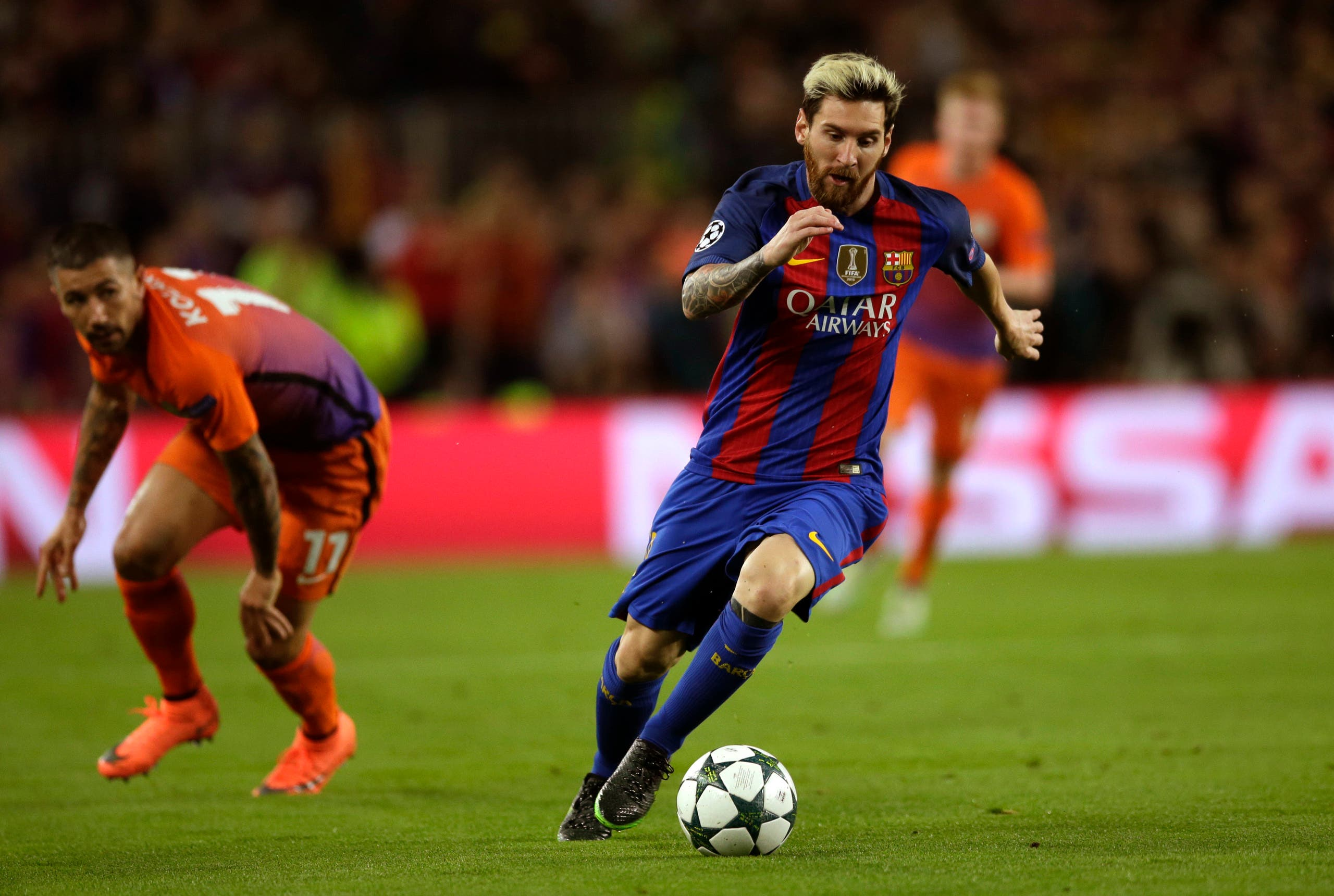 afe17472b43a Barcelona's Lionel Messi fights for the ball next to Manchester City's  Aleksandar Kolarov during a Champions League, Group C soccer match between  Barcelona ...