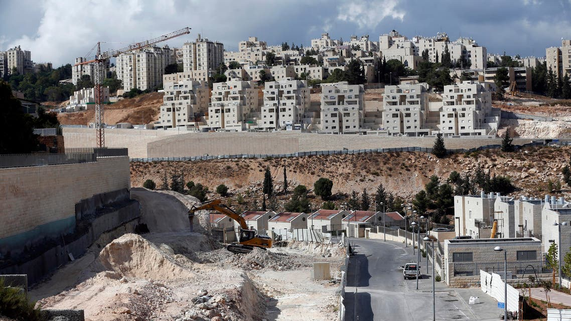 A general view taken on September 23, 2016 shows Israeli construction cranes and excavators at a building site of new housing units in the Jewish settlement of Neve Yaakov, in the northern area of east Jerusalem.   AHMAD GHARABLI / AFP