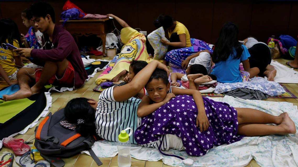 Residents who evacuated their homes due to Typhoon Haima take shelter at an evacuation centre in San Fernando, in northern Philippines, on October 19, 2016. (Reuters)