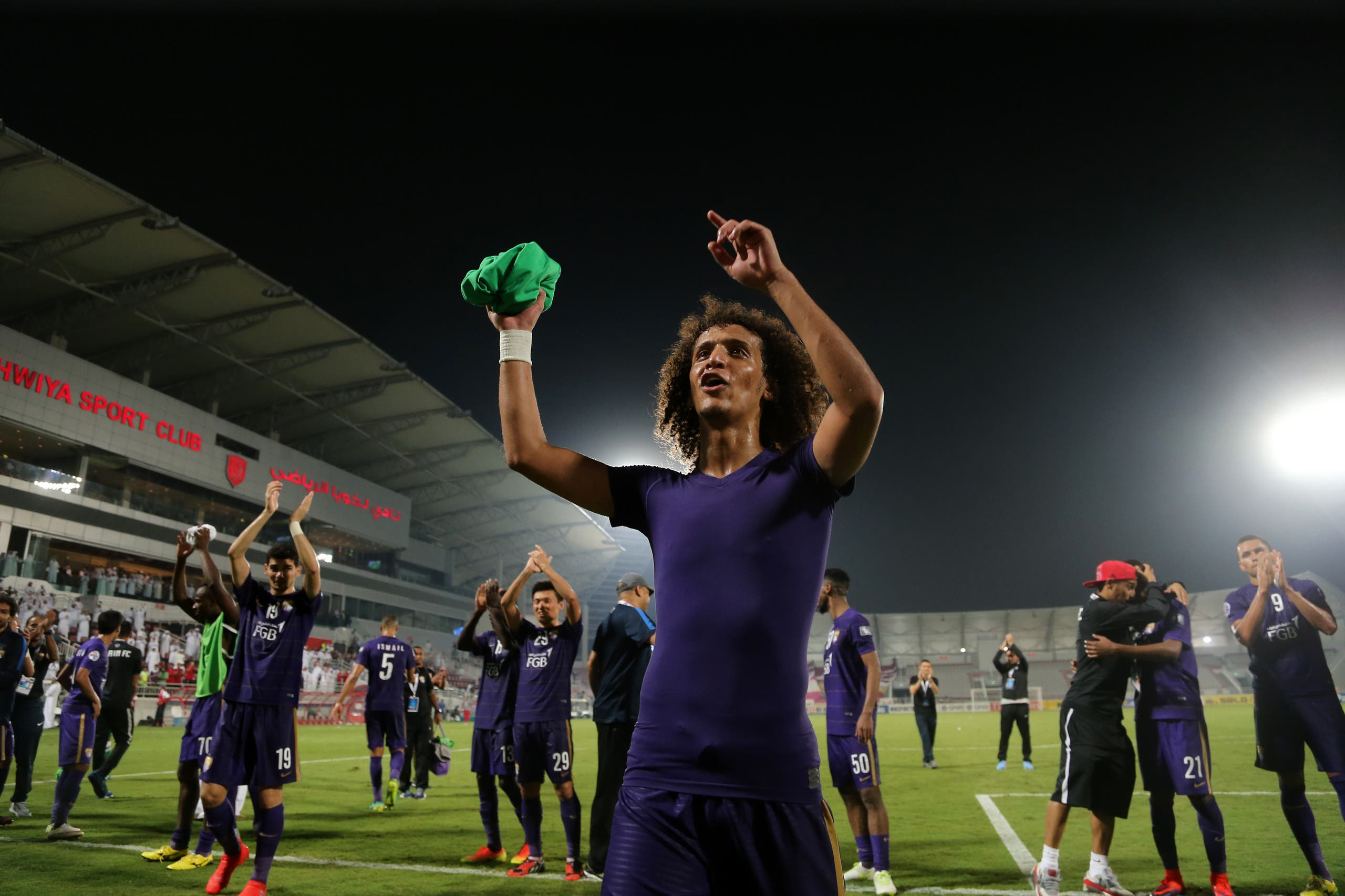 Al-Ain's Omar Abdulrahman (C) and teammate celebrate at the end of the Asian Champions League football return match between Qatar's El-Jaish and UAE's Al-Ain on October 18, 2016 at the Abdullah Bin Khalifa Stadium in Doha.  KARIM JAAFAR / AFP
