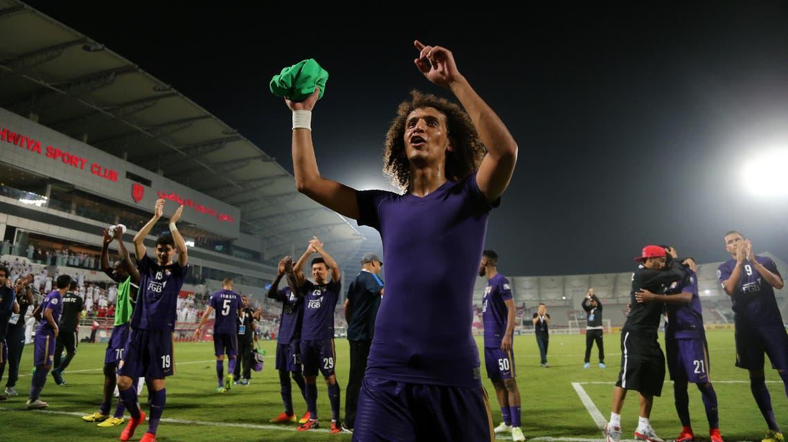 Al-Ain's Omar Abdulrahman (C) and teammate celebrate at the end of the Asian Champions League football return match between Qatar's El-Jaish and UAE's Al-Ain on October 18, 2016 at the Abdullah Bin Khalifa Stadium in Doha.  KARIM JAAFAR / AFP