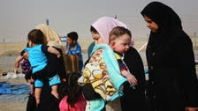Thousands of Iraqis flee Mosul to Syria