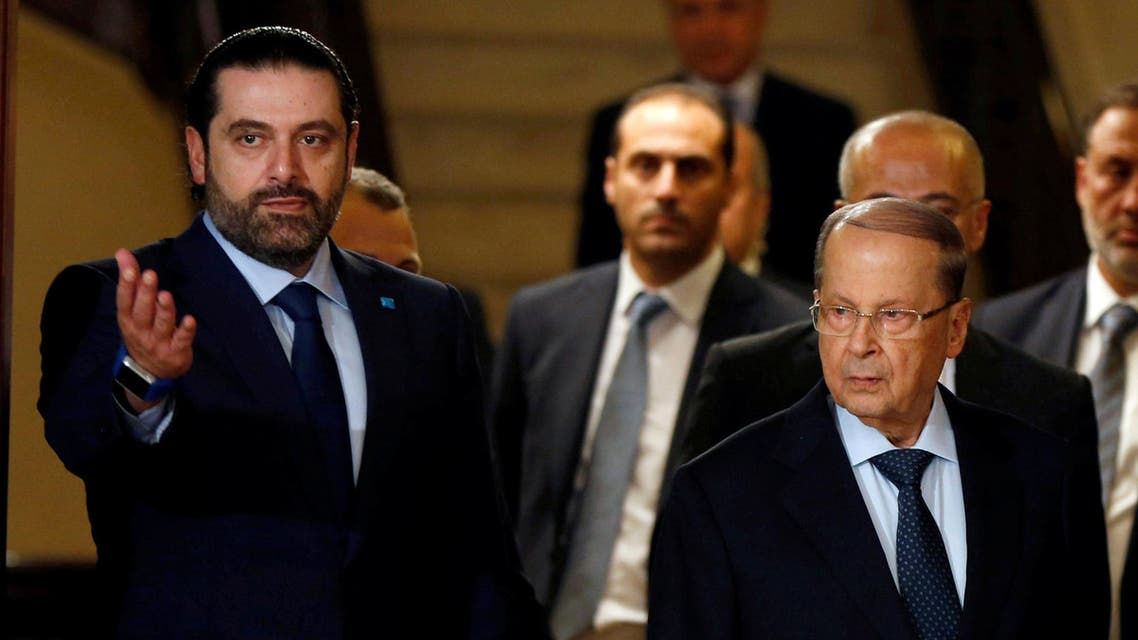 Christian politician and FPM founder Michel Aoun walks next to Lebanon's former prime minister Saad al-Hariri after he said he will back Aoun to become president in Beirut. reuters